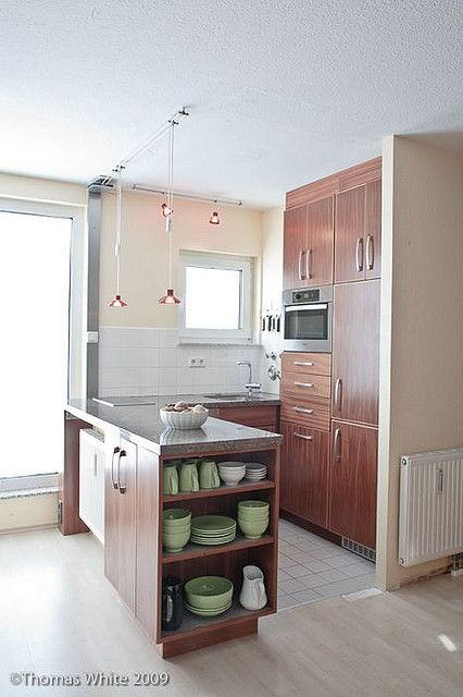 take out one cabinet, put in small breakfast bar with wine fridge in bottom. stools to sit at and eat.