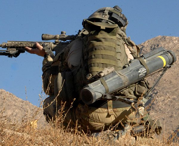 US Army Ranger taking aim with a SR-25 rifle and a M72 LAW slung across his back for instant support.