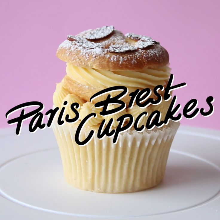 """Say """"bonjour"""" to your new fave dessert: vanilla bean cupcakes topped with Paris–Brest, a custard-filled French choux pastry."""