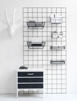 Buy a metal grid, add boxes etc. Use S hooks. Genius solution for keeping the entrance organized from all the small items spread around.