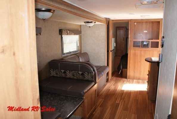 2016 New Gulfstream Amerilite 279BH Travel Trailer in Michigan MI.Recreational Vehicle, rv, The 279 Bunkhouse is a half-ton tow-able quad bunkhouse. With the super deluxe slide your whole family can eat and relax comfortably or bring a friend as the dinette and sofa both collapse for additional sleeping space. This unit can sleep up to ten. It has a master bedroom with two doors for privacy and dual wardrobes. Additionally, this unit also has a rear bunk room with four beds and a separate…