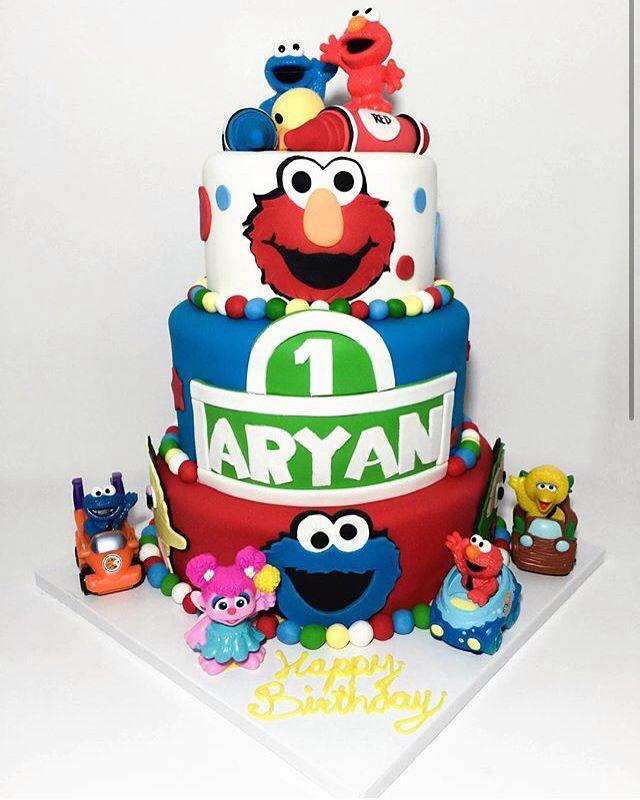 Wow. What a first birthday cake !   By: @bitsandbitesbakery  Fondant: @_virginice   #virginice #firstbirthday #happybirthday #cake #sesamestreet #elmo