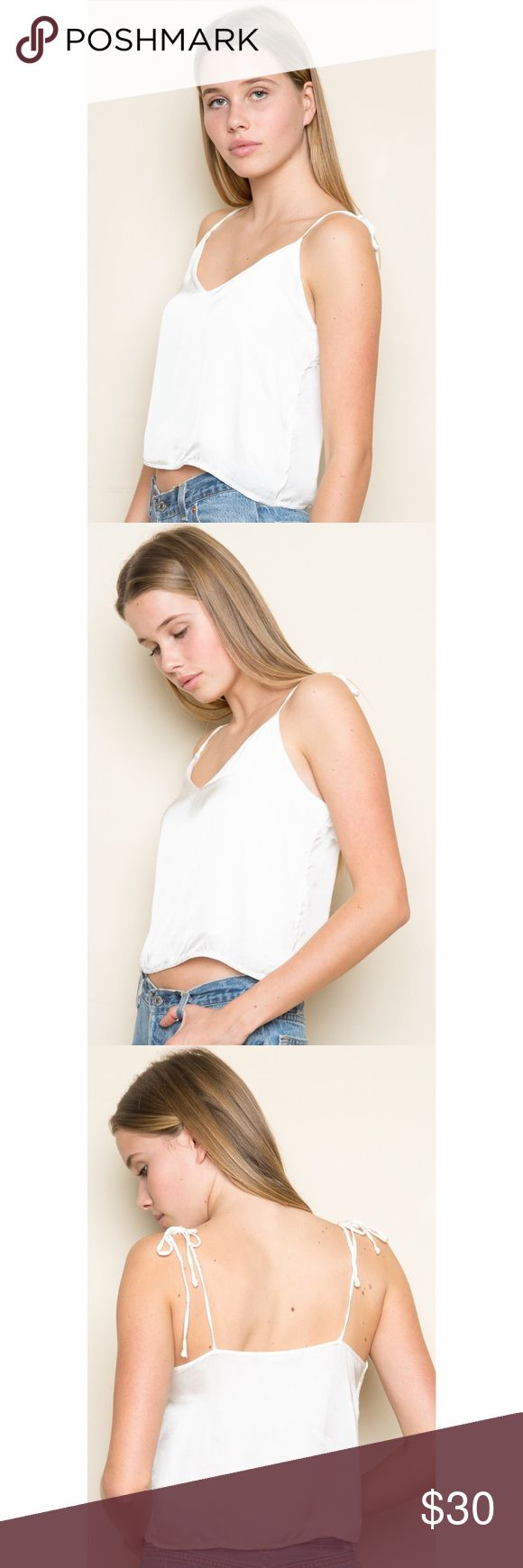 Brandy Melville Banks Top Silky white tank top with a v neck, partial lining and adjustable straps. Looks so cute with a t shirt under or worn by itself. Brand new with tags. One size but will best suit an extra small/small Brandy Melville Tops Tank Tops