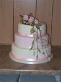 Image detail for -3 tiered oval wedding cake with lilac flowers as decoration.