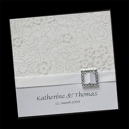 """Inspiration Card.   6"""" x 6"""" square invite with lace embossing on top, ribbon border in navy, silver bow or other embellishment, names at bottom with wedding date."""