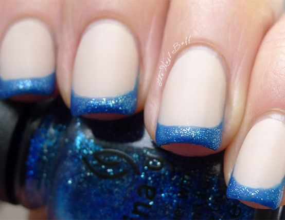 White matte nail base with blue glitter french manicure tips, free hand nail art