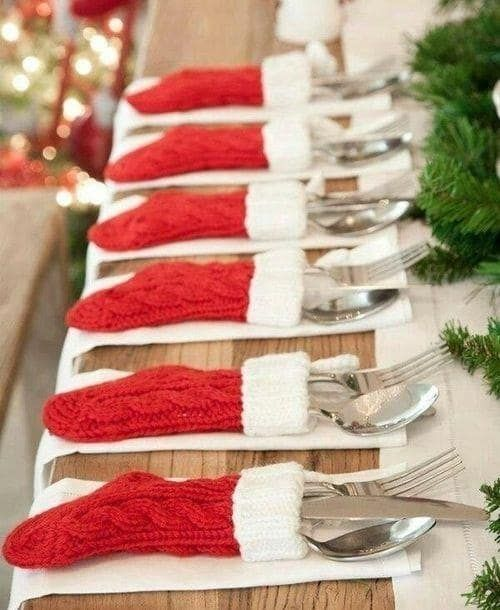 Buy a bunch of mini stockings at the craft store, and use them to hold utensils at your Christmas table, as done here.