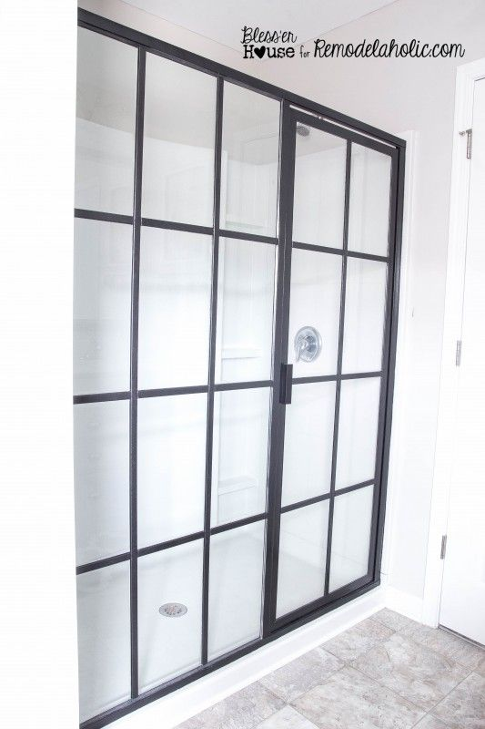 DIY industrial factory shower door from Bless'er House. $60  for basic silver to this with panes added.
