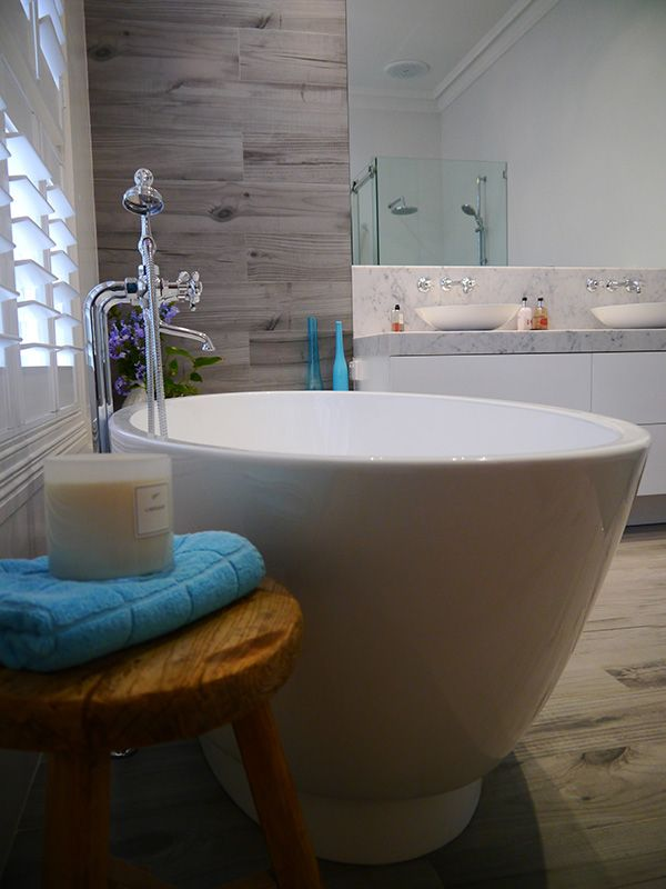 eat.bathe.live :: ensuite designed by eat.bathe.live featuring a beautiful freestanding bath and timber look tiles