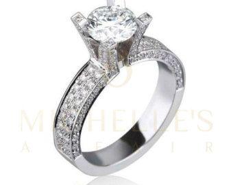 Diese wunderschönen Verlobungsring hat ein total Diamant-Karat-Gewicht von 1,65 ct. und Features einer wichtigsten 0.90 ct H/VVS1 Kissen Diamant entlang mit D/VS Seite Diamant geschnitten Akzenten mit einem kombinierten Karatgewicht 0,75 ct., alles wunderschön einer 18K Weissgold mit einem gold ca. 3 Gramm inmitten liegt. Dieser Ring eignet sich für verschiedenste Anlässe, ob es sich um einen Vorschlag, Verlobung, Jahrestag oder einem anderen sinnvollen Zeitpunkt handelt. Eine Sache ist…