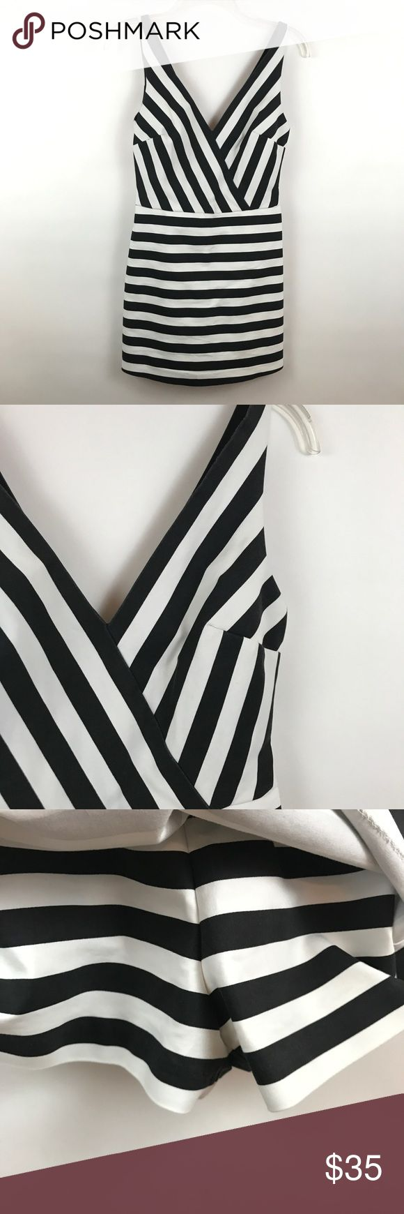 "ZARA | Black White Stripe Skirted Romper B3 Condition: Excellent pre owned condition Measurements (laying flat): 14.5"" pit to pit 29"" length 2"" inseam  Item location: bin 3 Zara Pants Jumpsuits & Rompers"