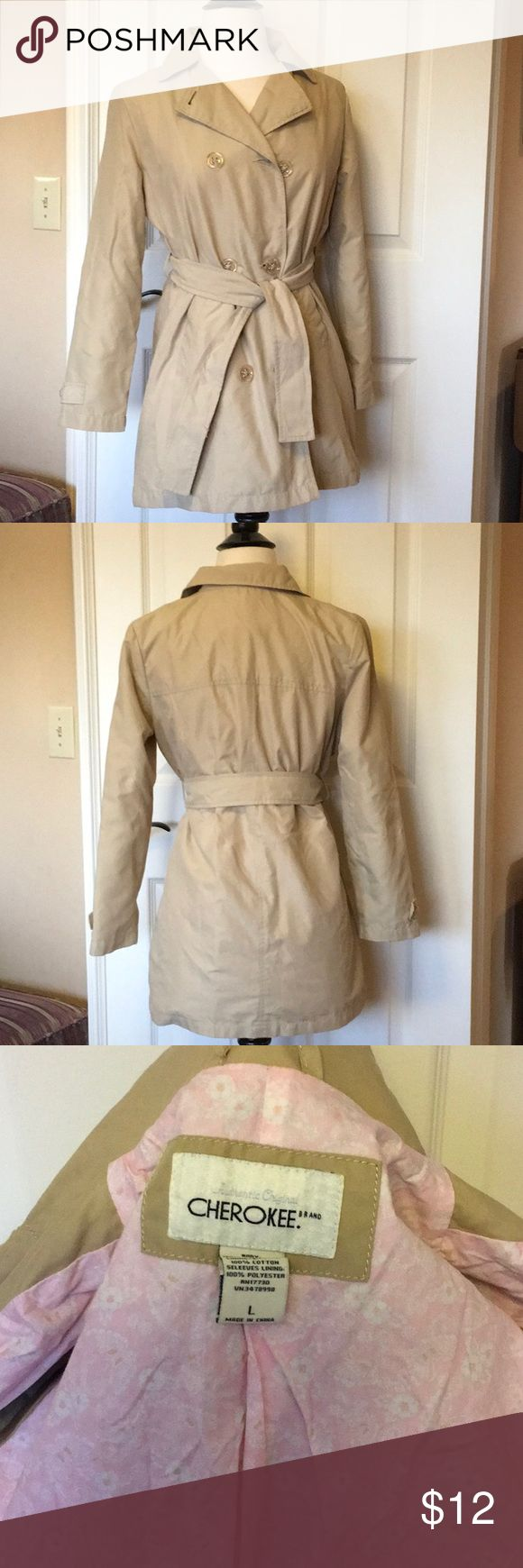 Girls Trench button and tie coat jacket Awesome trench coat by Cherokee. Outer 100% polyester, lining 100% cotton Lined in a cute pink floral print.  Excellent condition Cherokee Jackets & Coats Pea Coats