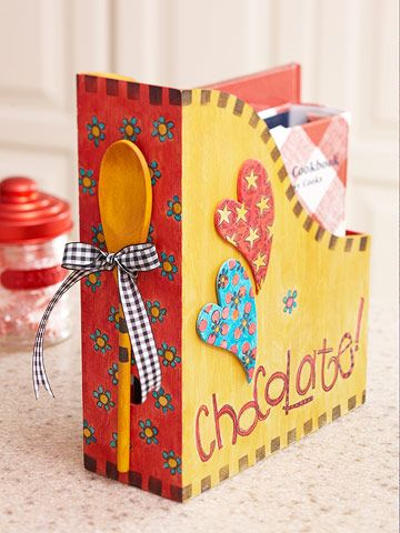 Cookbook Holder.  Turn a magazine holder into fun and functional kitchen decor. Paint tiny designs on chipboard shapes and the base of the holder. Instead of the wooden spoon on the back, add a title.  Make several that match for different themes (dessert, low carb, slow cooker, kids, etc).