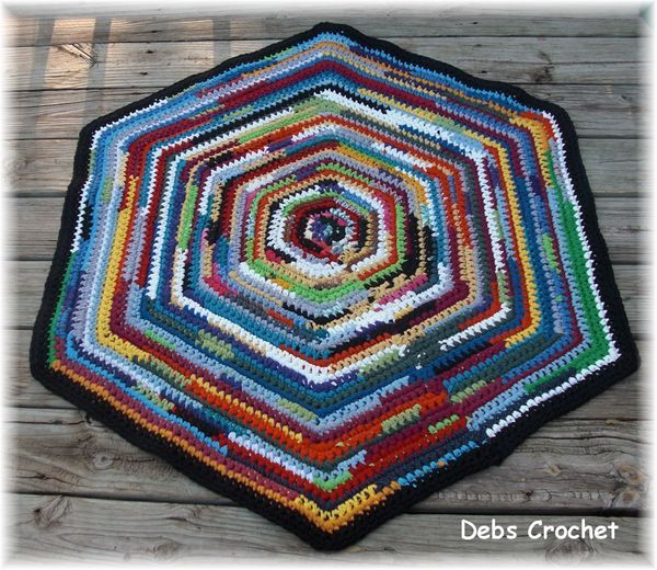 crochet rug from t-shirt yarn. cut one inch strips..pull to curl and crochet like mad. :)