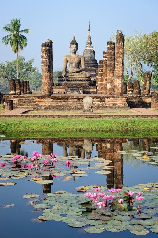 Buddha resting at the bank of a lily pond, Sukhothai, Thailand.
