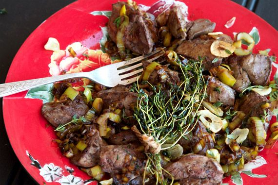 Fried chicken livers in garlic, thyme and sweet balsamic leeks. Yum and so nutritious!