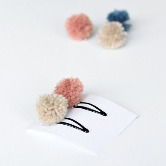 Make these pretty pom pom hair clips. They make great handmade gifts and party favors for kids parties.