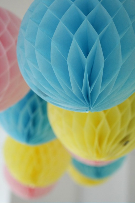 Yellow, turquoise and pink paper globes continue the party theme indoors...