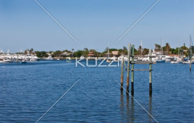 Pilling Isolated in Salt Water Marina Area - A large body of salt water with a collection of four pillings as the focus