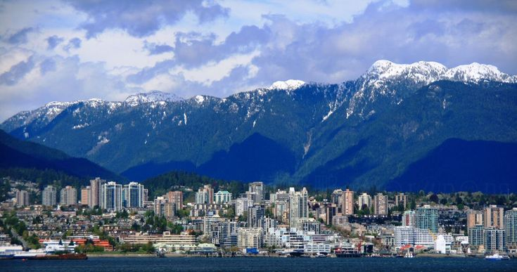 Landscape: urban design complimenting the North Shore Mountains of Vancouver, Canada.  --Love the cityscape and how it parallels with the mountain snowy tops.  beautiful backdrop!