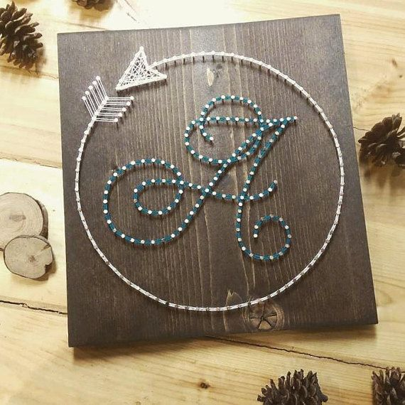 Hey, I found this really awesome Etsy listing at https://www.etsy.com/listing/265838821/circle-arrow-initial-string-art