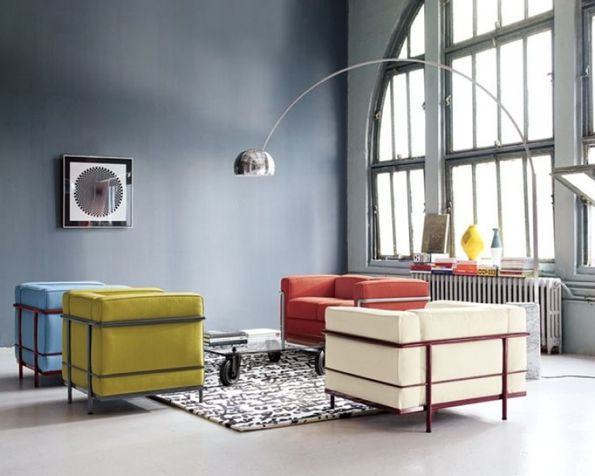 Le Corbusier. The chairs anyway, I assume. I like the lamp. I want that lamp in my living room.