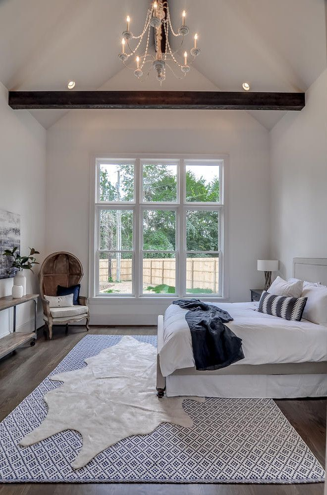 Bedroom With Vaulted High Ceiling And Rustic Beam Domaine Development Garrett Buell Photography