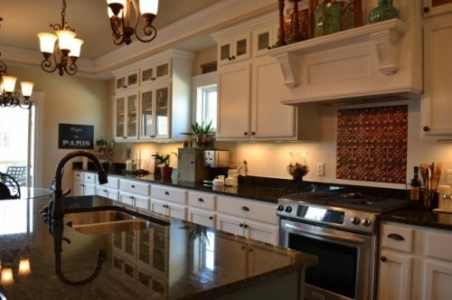 White cabinets dark counters subway tile backsplash tin Kitchen remodeling valparaiso indiana