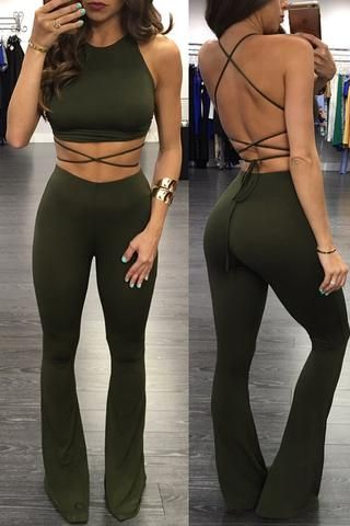 Olive green two piece tight fitting set with strappy open back and flared pant leg.