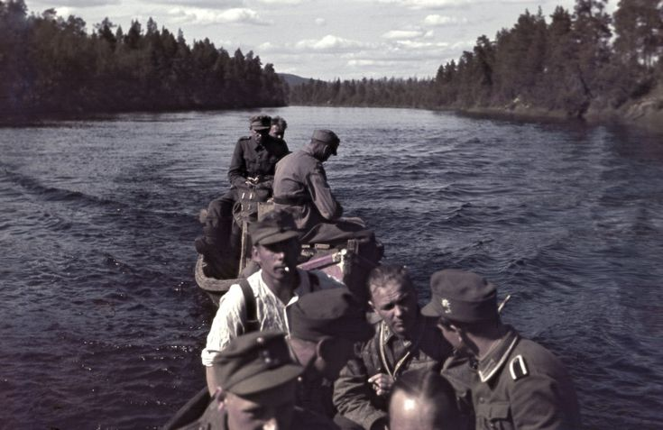 Finnish soldiers and German huntsman paddle boats on the river in the Arctic Lutto