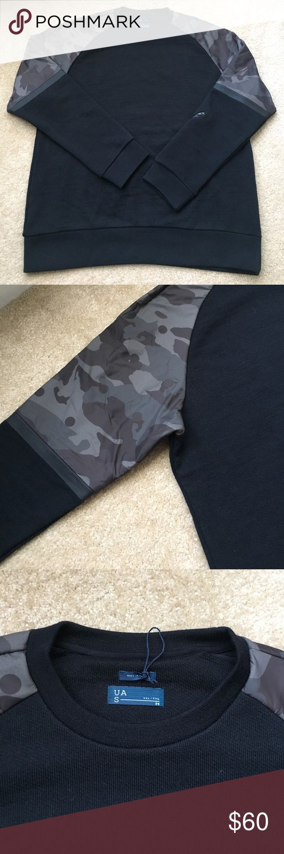 """Moving Sale Under Armour Camouflage Sweatshirt Men's UAS line by Under Armour.   Never worn.  Crew neck black sweatshirt with camouflage accent shoulders.  Zipper on left sleeve. Measures 30"""" from neck to hem. Under Armour Shirts Sweatshirts & Hoodies"""