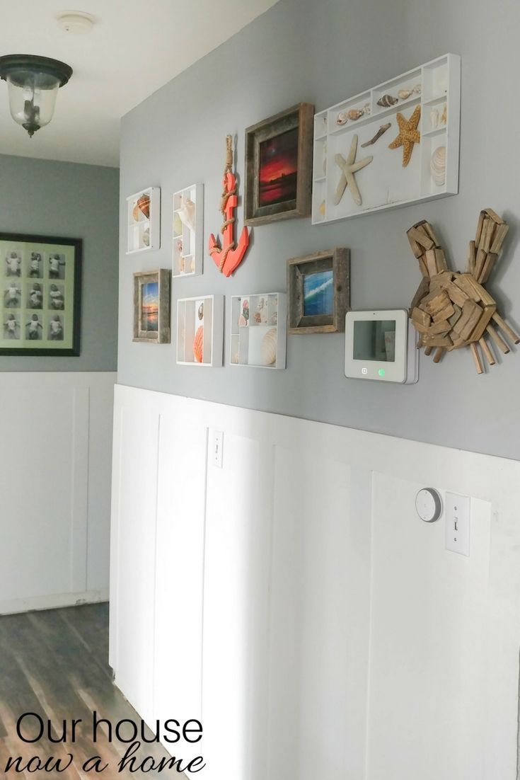 DIY coastal gallery wall and shell display. Simple way to display those vacation finds from the beach! Easy and low cost upcycle idea using kids wooden toy containers. Great way to personalize a home!