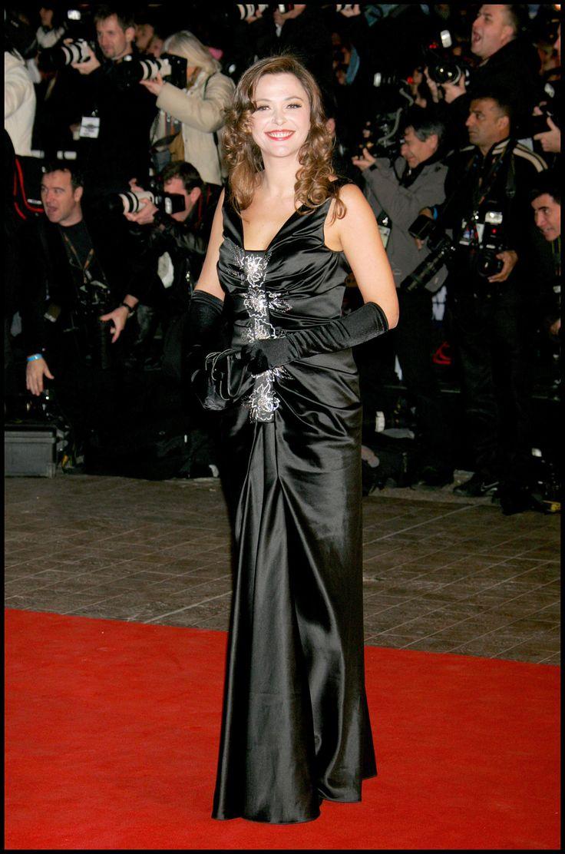 Sandrine Quetier wearing satin opera gloves.
