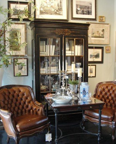 Display of wall art around cabinet