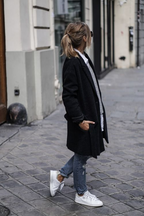 Camille Callenlooks cool and casual in ripped denim mom jeans...