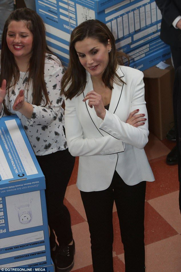 Putting on a stylish display, the Spanish Royal opted for a white blazer with black piping, layering it with a black lace vest
