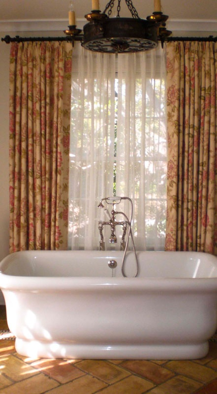 Closing Drapes With Sheers Behind On Wood Poles With