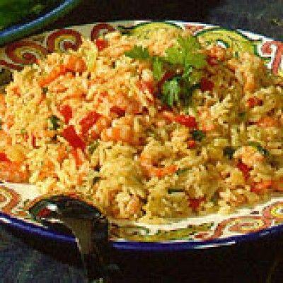 Paella van de arme man   is een lekker recept en bevat de volgende ingrediënten: 1 ui, 2 vleestomaten, 300 gr. kipfilet, 100 gr. ham, in dikke plak, 250 gr. rijst, kortkorrelige, 100 gr. salami, in plakjes, 4 dl. kippenbouillon, 1 dl. sherry, droge, 2 el. olijfolie, 2 el. peterselie, verse, fijngehakte, 1 mespunt peperkorrel, witte, gemalen, 1 mespunt cayennepeper, 1 mespunt paprikapoeder, 1 mespunt chilipoeder, 1 mespunt tijm, gedroogde, 1 mespunt mosterdpoeder, 1 mespunt koenjit, 2…