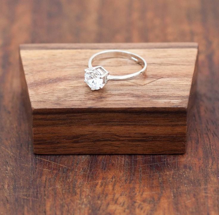 """The Mountain"" ringbbox available in store with free worldwide shipping! . . . . . #engagement #ring #box #wedding #engaged #engagementring #diamond #proposal #beautiful #weddingring #diamondring #woodworking #wood #handmade #woodwork #design #custom #walnut #handcrafted #art #etsy #craft #woodcraft #etsyshop #etsyseller #etsyfinds #gift #thenorthernforest"