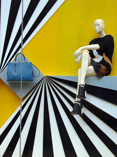 "Window Visual Merchandising | VM | Window Display | Fendi, Window Display: great use of contrast and linear eye-paths... If the grey shelf holding the bag had been painted to match the yellow background (making that blue ""pop""), more attention would go to the bag!"