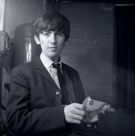 George Harrison, backstage at East Ham 1963.  Photographer Jane Bown with the Beatles