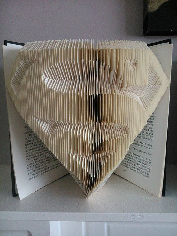 Hey, I found this really awesome Etsy listing at https://www.etsy.com/listing/207320941/book-folding-pattern-in-superman-style