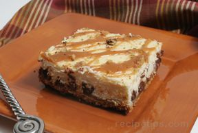 Turtle Cheesecake Bars Recipe from RecipeTips.com!