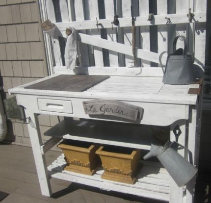 Potting Bench - JUNKMARKET Style: Old table, shelves, steel bins and some old rusty toolson fencing to hang stuff..this is all junk and beautiful!