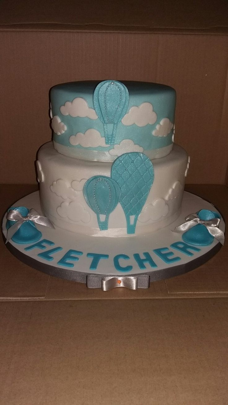 Hot air balloon and fluffy clouds, booties, edible decorations, 2 tier Vanilla and Lemon by Danielle Smith ( Rockylicious Cakes )
