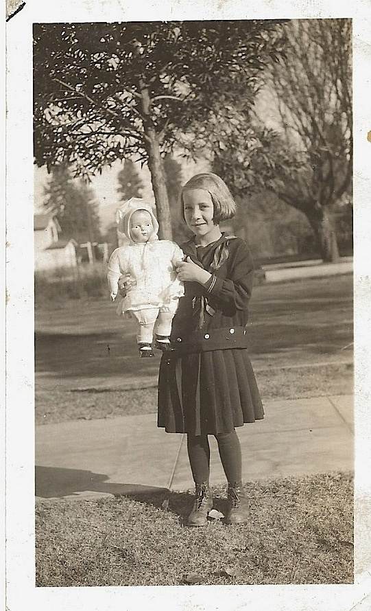 Girl with her prize doll  No date.
