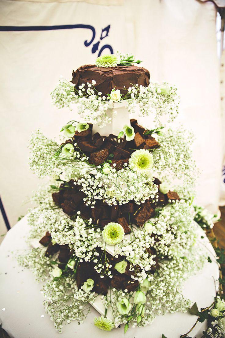 Quaint Cornish Wedding | Incredible chocolate brownie & flower cake!| See more at Whiter than White Weddings | Photo: Alan Law