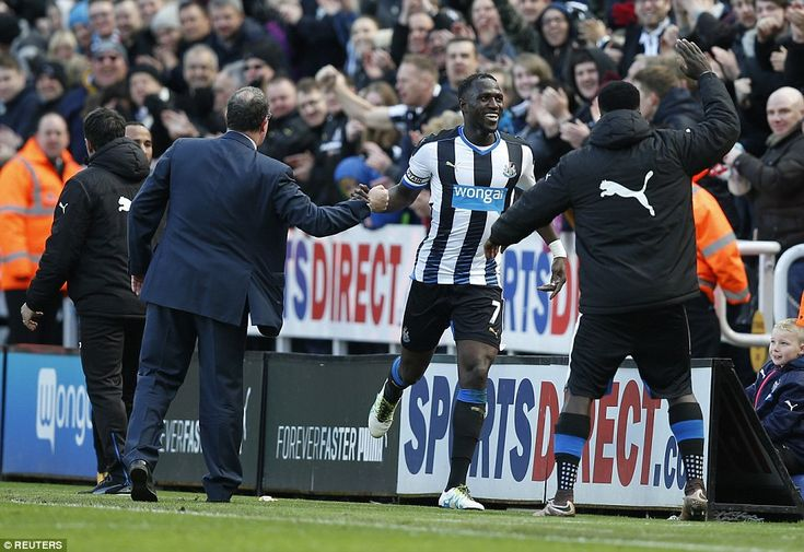 Moussa Sissoko celebrates with boss Rafa Benitez after doubling Newcastle's lead with a close range finish in the second half