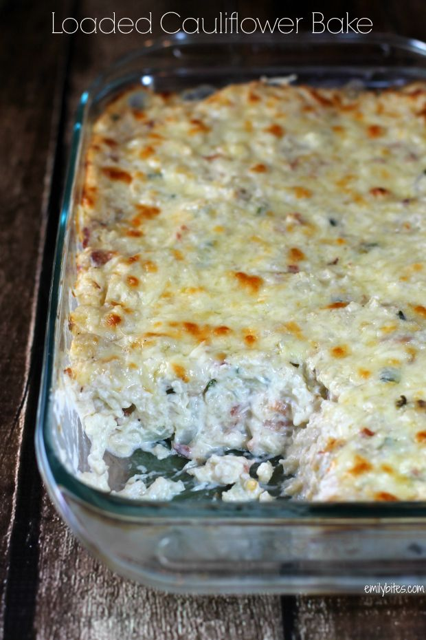 This Loaded Cauliflower Bake takes all the things you love about loaded mashed potatoes (the gooey cheese, the smoky bacon, the fresh scallions and the creamy sour cream) and gives them a healthier, low carb base. Only 164 calories or 4 Weight Watchers points per serving! www.emilybites.com