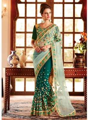 #Designer #Green #Saree Features on net and georgette fabric saree with Heavy zari, resham embroidery with stone work and lace border, Blouse is on art silk and georgette fabric sleeves.
